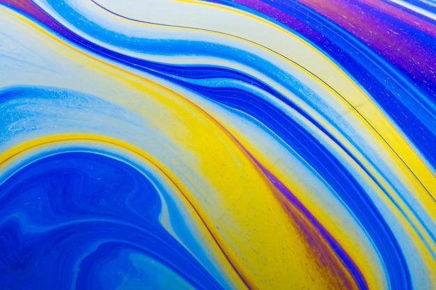 Fundo abstrato azul e amarelo ondulado reluzente Foto gratuita
