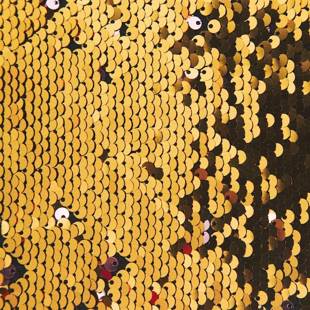 Fundo abstrato com lantejoulas de ouro cor no tecido Foto gratuita