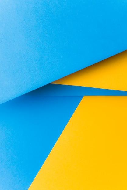 Fundo abstrato de papel amarelo e azul em branco Foto gratuita