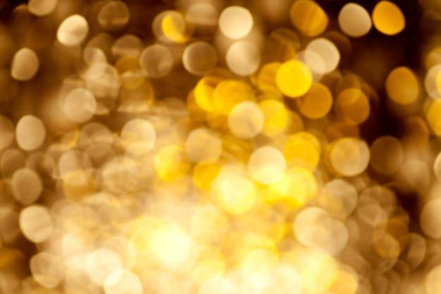 Fundo abstrato dourado luzes desfocadas Foto Premium