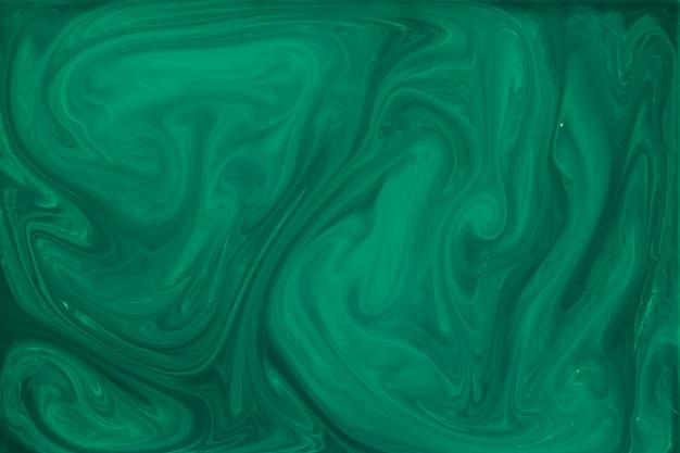 Fundo abstrato fluido verde marmorizado Foto gratuita
