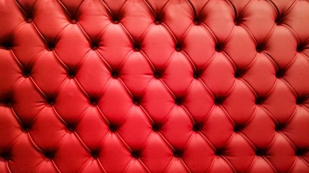 Fundo acolchoado vermelho do sofá Foto gratuita
