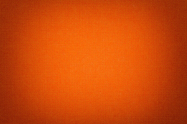 Fundo alaranjado brilhante de um material de matéria têxtil com teste padrão de vime, close up. Foto Premium