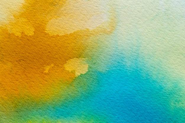 Fundo amarelo e azul aquarela abstrato Foto gratuita
