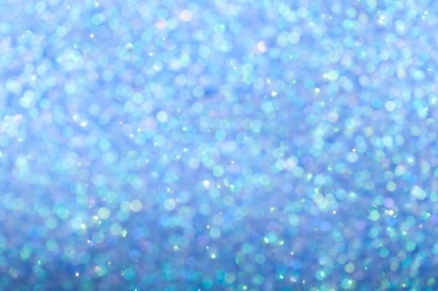 Fundo azul brilhante turva com luzes cintilantes. Foto Premium