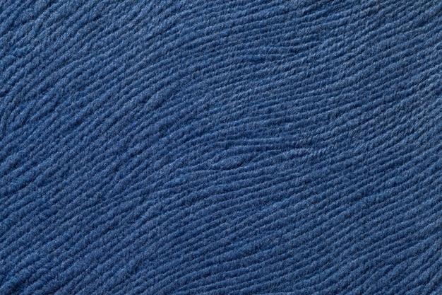 Fundo azul escuro de material têxtil suave. tecido com textura natural. Foto Premium