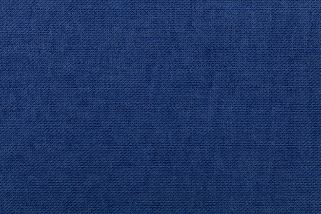 Fundo azul escuro de material têxtil. tecido com textura natural. Foto Premium