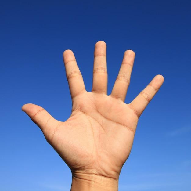 Fundo azul mãos mão humana Foto gratuita