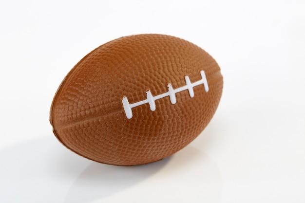 Fundo branco de futebol americano, close-up Foto Premium