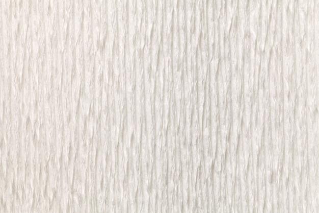 Fundo branco estrutural de papel ondulado, close-up. Foto Premium