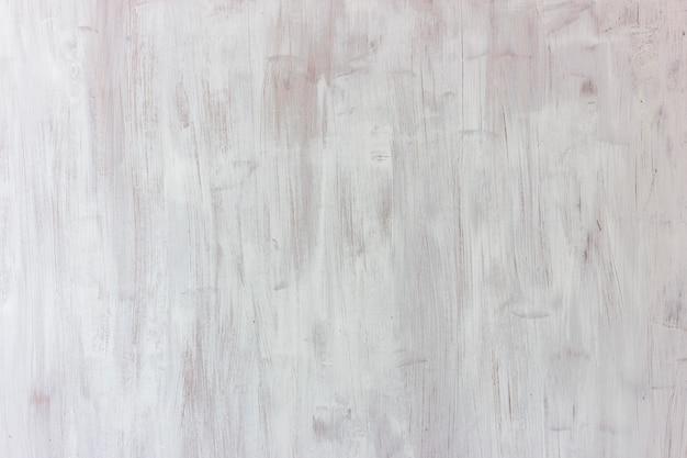 Fundo branco. placa de madeira texturizada, pintada com traços largos Foto Premium