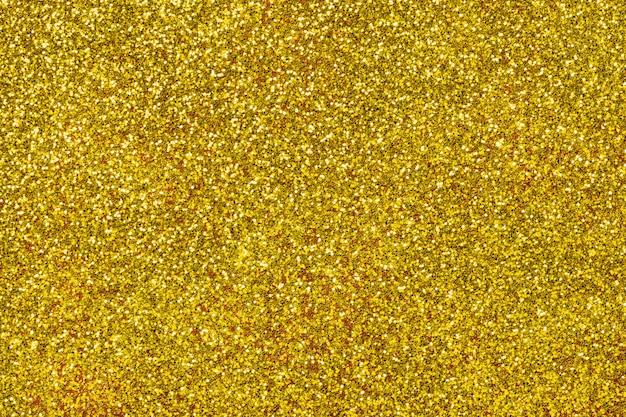 Fundo cintilante dourado de pequenas lantejoulas Foto Premium