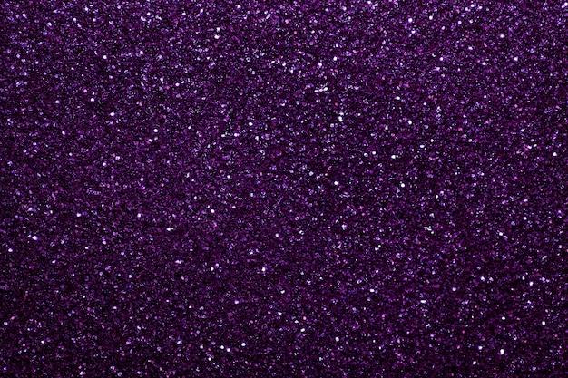 Fundo cintilante roxo escuro de pequenas lantejoulas, closeup Foto Premium