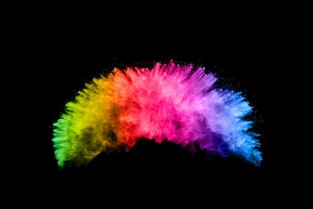 Fundo colorido de pó de giz. as partículas de poeira da cor splattered no fundo branco. Foto Premium