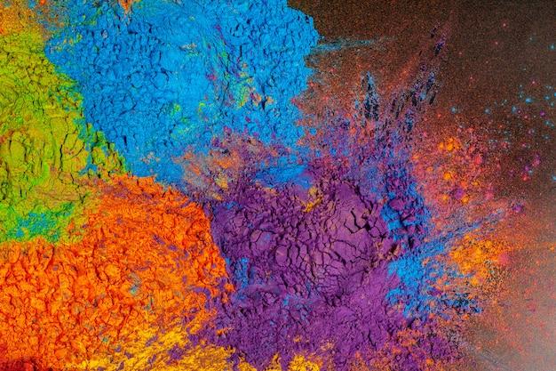 Fundo colorido feito de corantes coloridos indianos Foto Premium