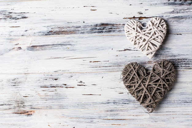 Fundo com corações, dia dos namorados. dia dos namorados. ame. corações de vime. romântico. Foto Premium