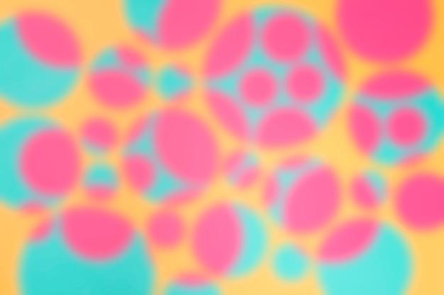 Fundo com design abstrato círculo desfocado Foto gratuita