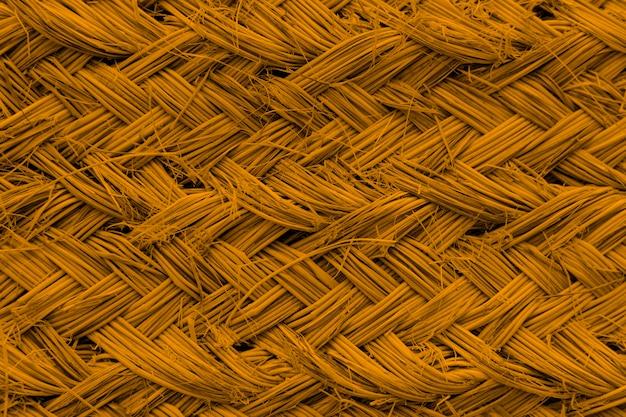 Fundo com textura de vime âmbar brilhante Foto gratuita