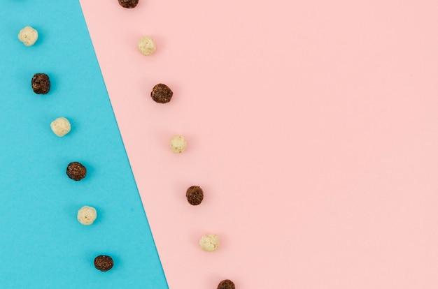 Fundo contrastado com cereais coloridos bonitos Foto gratuita