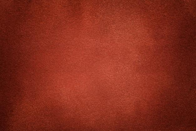 Fundo da obscuridade - close up alaranjado da tela da camurça. Foto Premium