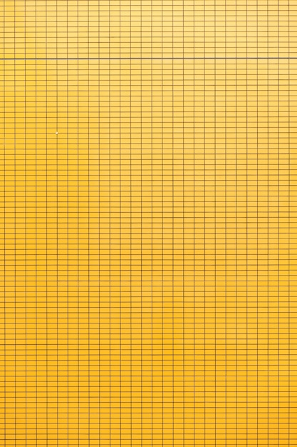 Fundo da parede de cerâmica amarela. Foto Premium