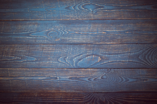 Fundo das placas de madeira da textura com os restos da pintura azul e violeta. vinheta Foto Premium