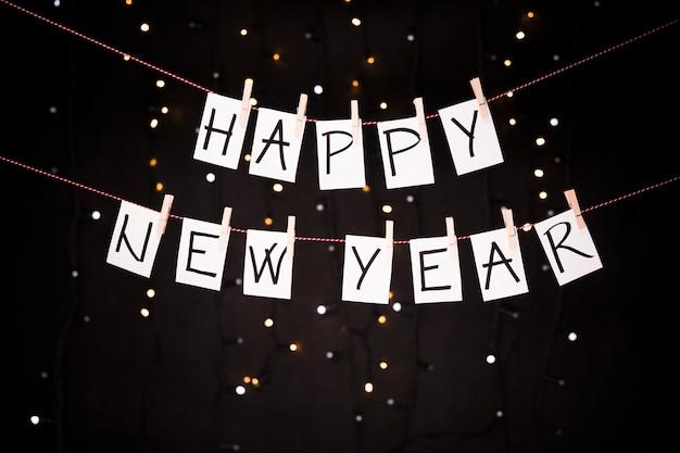 Fundo de ano novo com varal Foto gratuita