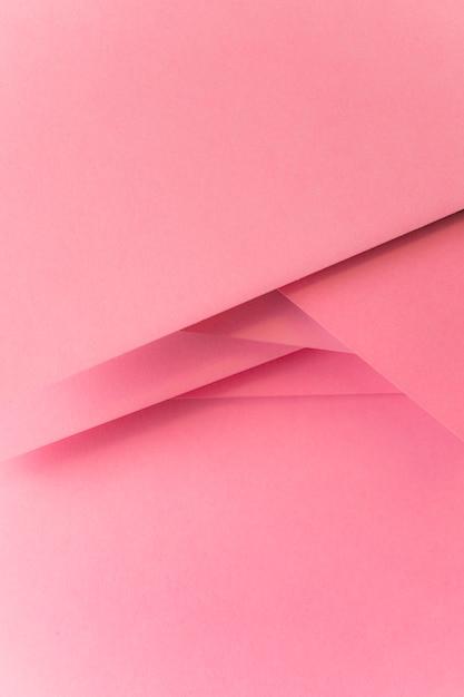 Fundo de banner de papel colorido rosa pastel Foto gratuita