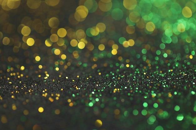 Fundo de brilho verde e ouro com brilho bokeh Foto Premium