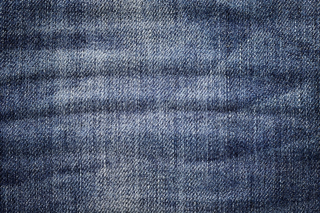 Fundo de calça jeans escura. textura denim clássico. superfície de roupas da moda. Foto Premium