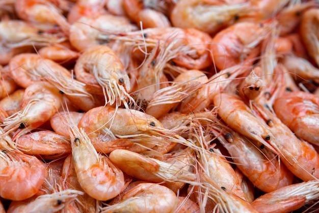 Fundo de camarão cozido, vermelho com profundidade de campo rasa Foto Premium