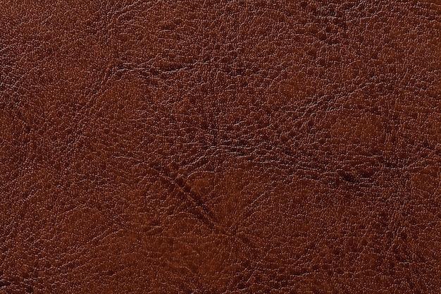 Fundo de couro da textura do marrom escuro, close up. pano de fundo rachado de bronze da pele do enrugamento Foto Premium