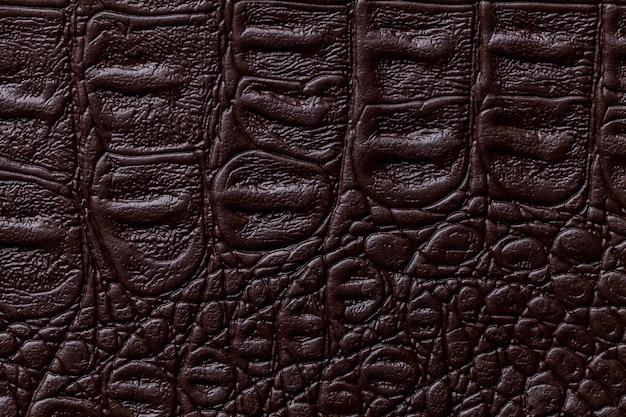 Fundo de couro marrom escuro, closeup Foto Premium