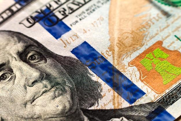 Fundo de dinheiro notas de cem dólares dos eua Foto Premium