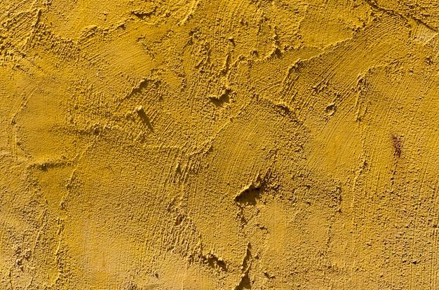 Fundo de estuque de parede amarelo Foto Premium