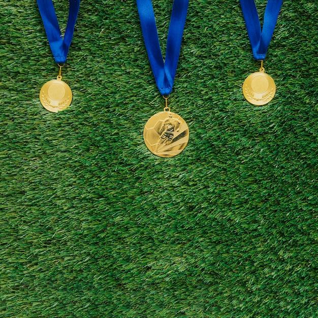 Fundo de futebol com medalhas Foto gratuita