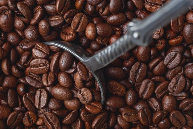 Fundo de grãos de café torrados. vista do topo Foto Premium