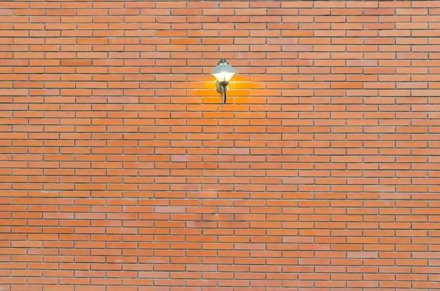 Fundo de grunge de textura de parede de tijolo vermelho com cantos vignetted do interior Foto Premium