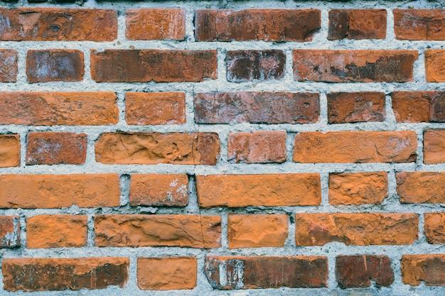 Fundo de grunge de textura de parede de tijolo vermelho velho com cantos vignetted Foto Premium