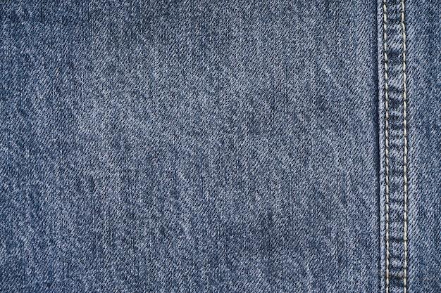 Fundo de jeans, jeans com costura de design de moda, espaço para texto. postura plana Foto Premium