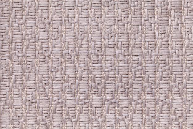 Fundo de lã tricotado marrom com um padrão de pano macio e fofo. textura de closeup de têxteis. Foto Premium