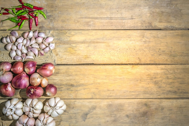 Fundo de legumes saudável jardim shallot tailandês alho pimenta tailandesa Foto Premium