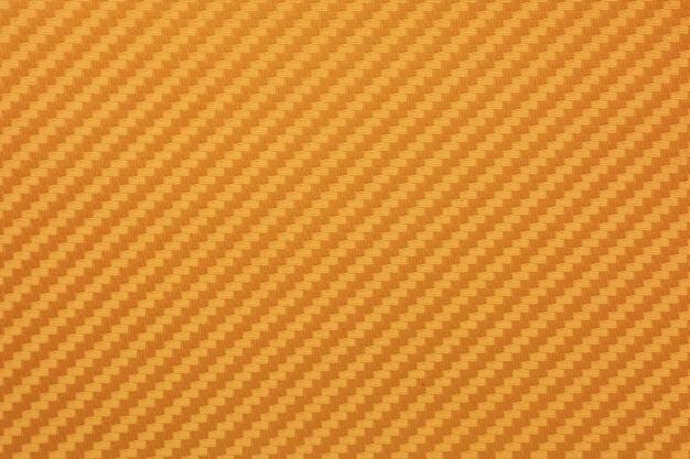 Fundo de matéria-prima composto de fibra de carbono de ouro Foto Premium