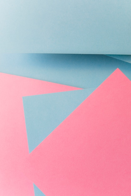 Fundo de papel de cor cinza e rosa de forma geométrica abstrata Foto gratuita