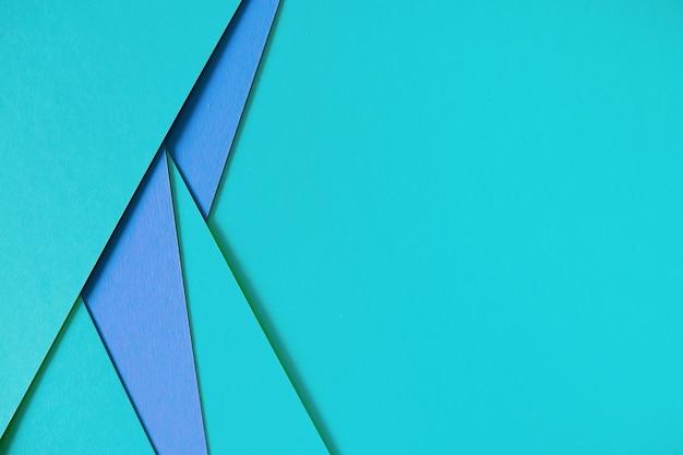 Fundo de papelão de composição geométrica azul com copyspace Foto gratuita