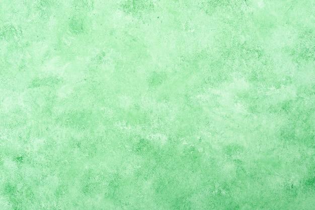 Fundo de parede de estuque texturizado verde fresco Foto gratuita