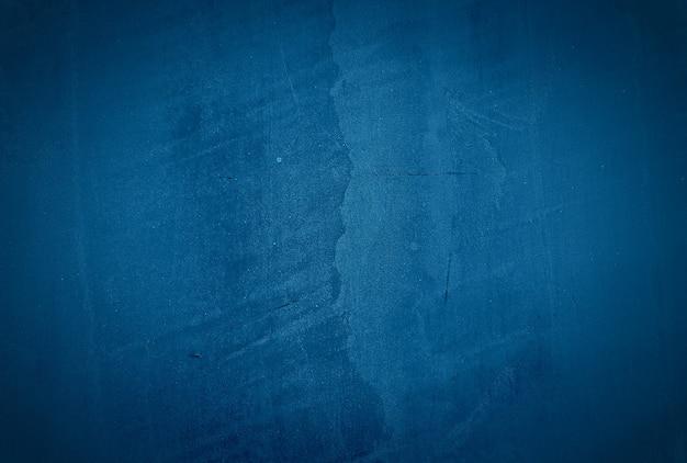 Fundo de parede do estúdio de textura de concreto azul vintage grunge com vinheta. Foto gratuita