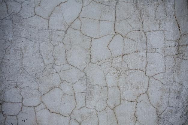 Fundo de parede rua cinza envelhecido, textura com rachaduras e arranhões Foto Premium