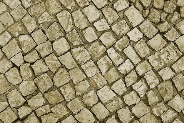 Fundo de pavimento de pedra bege velho Foto Premium