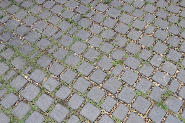 Fundo de pedra do revestimento da passagem do tijolo. Foto Premium